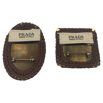 Prada Two brooches