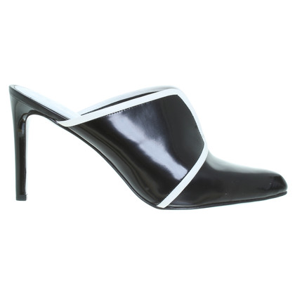 Kenzo Mules in black and white
