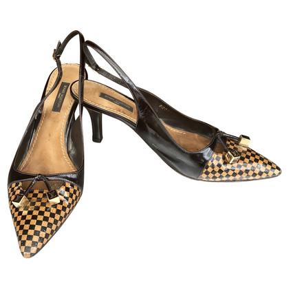Louis Vuitton Sandalen in zwart en beige leer