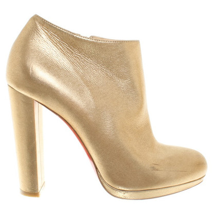 Christian Louboutin stivali color oro