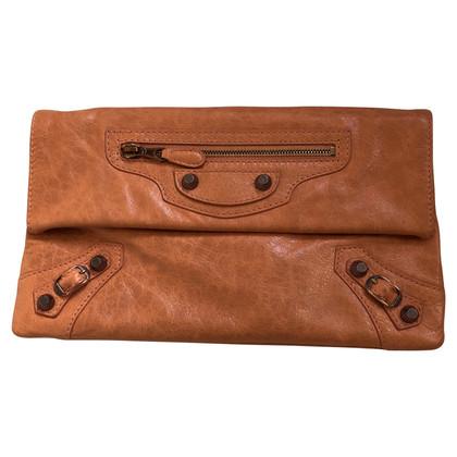 Balenciaga clutch in orange-brown