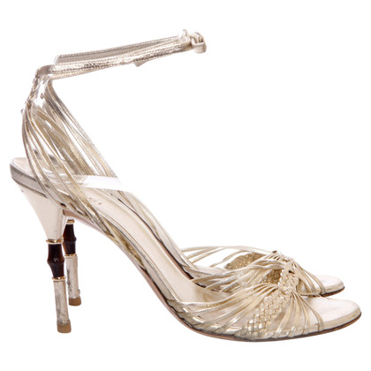 Gucci Goldfarbene Sandaletten