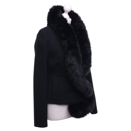 Hussein Chalayan Coat with faux fur trim