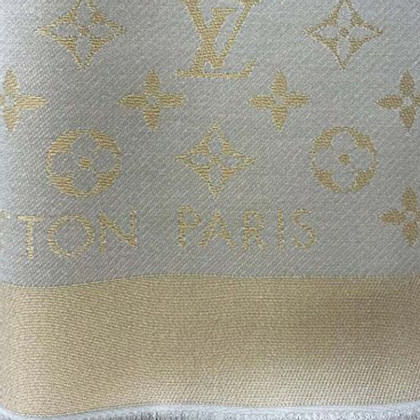 Louis Vuitton Monogram Shine cloth in beige / gold