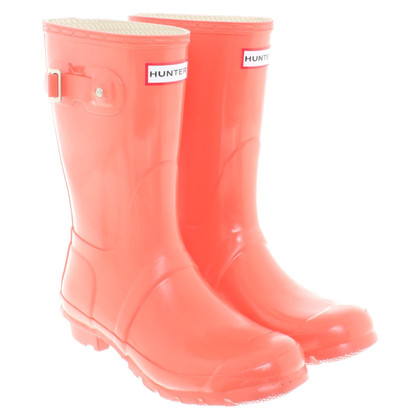 Hunter Wellington boots in coral red