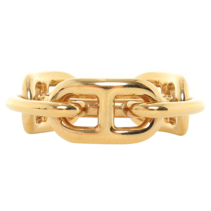 Hermès Gold colored cloth ring with bag