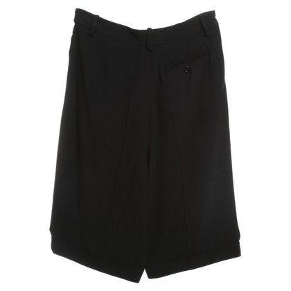 Alexander McQueen Shorts with pleats