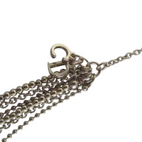 Christian Dior Asymmetrical chain.