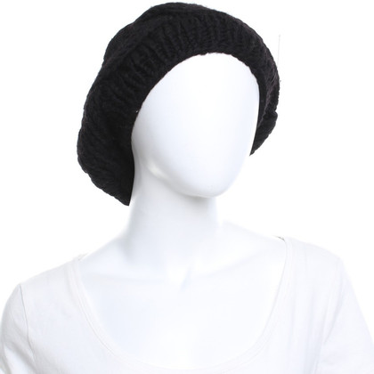 Karl Donoghue Bonnet de laine avec peau de mouton