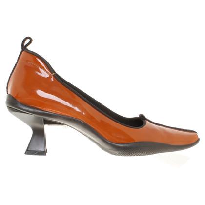 Prada pumps in patent leather
