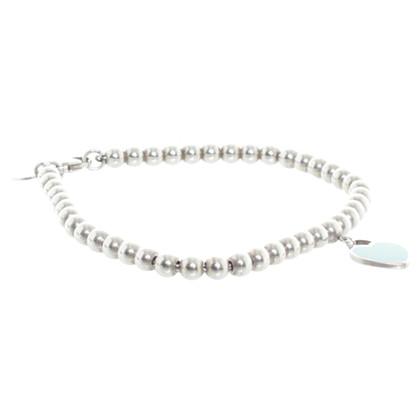 Tiffany & Co. Ball bracelet with heart pendant