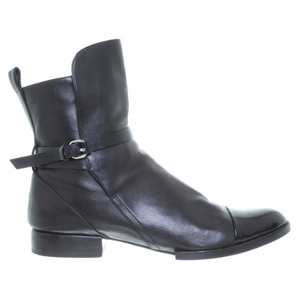 Maison Martin Margiela Leather ankle boots in black