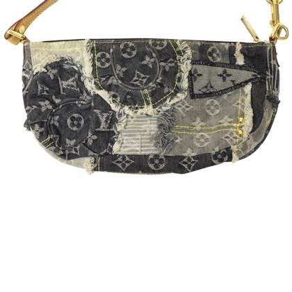 Louis Vuitton clutch in Monogram Denim