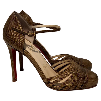 Christian Louboutin pumps in golden brown