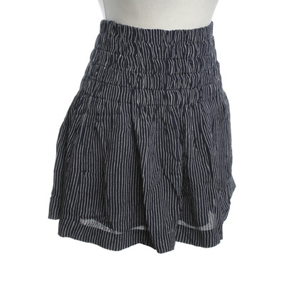 Ganni Short with flower pattern and fringes in black