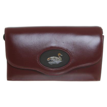 Hermès Ruby-colored capes clutch