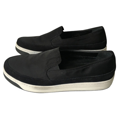 Prada Slip ons in black