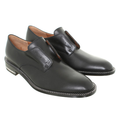 Givenchy Leather slippers in black