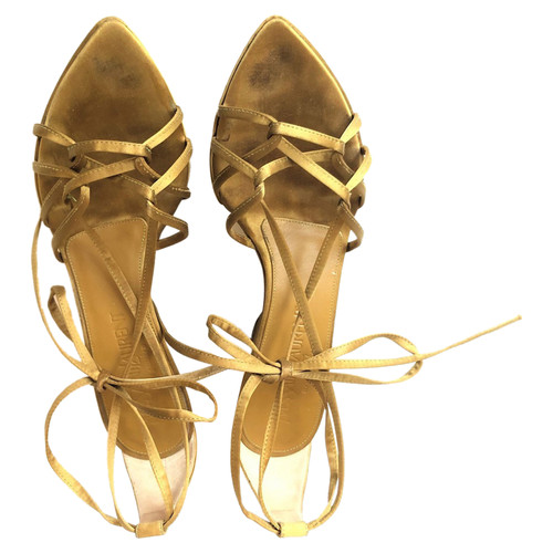 02bf2a28560 Yves Saint Laurent Sandals in Gold - Second Hand Yves Saint Laurent ...