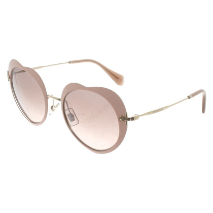 Miu Miu Sunglasses in blush pink / Gold