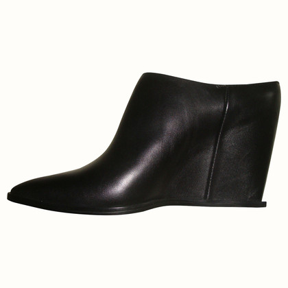 Costume National Mules with wedge heel
