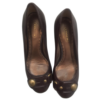 Coach pumps in brown
