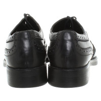 Pollini Lace-up shoes in black