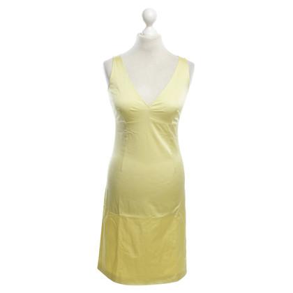 Schumacher Displayed dress in citrus yellow