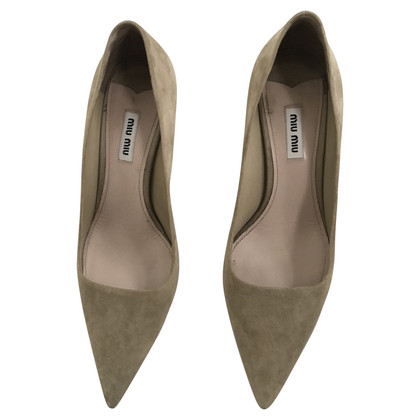 Miu Miu pumps in cream