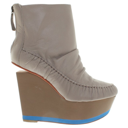 Finsk Leather ankle boots with wedge heel