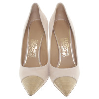 Salvatore Ferragamo pumps with gold-coloured top