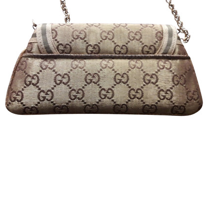 Gucci Gold color clutch