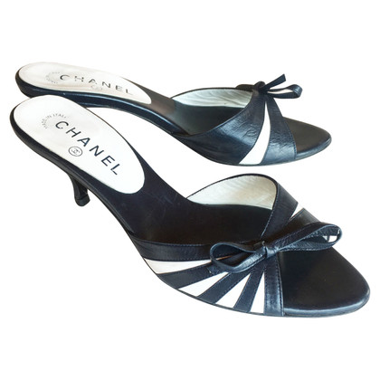Chanel Mules in blue / white