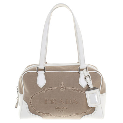 Prada Handbag in beige / white
