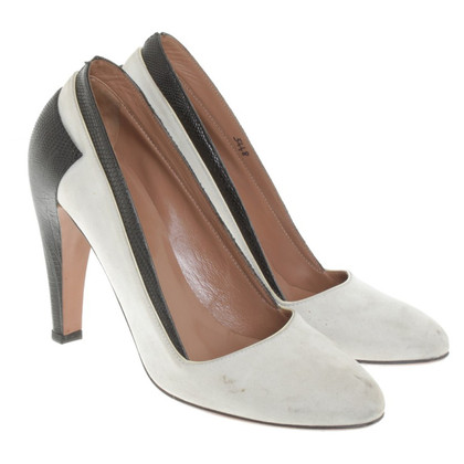 Alaïa pumps in Nude / Black