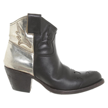 Golden Goose Boots in black / gold