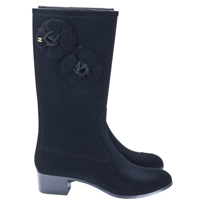 Chanel Rain boots with camellias