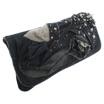 Blessed & Cursed clutch with jeans draping