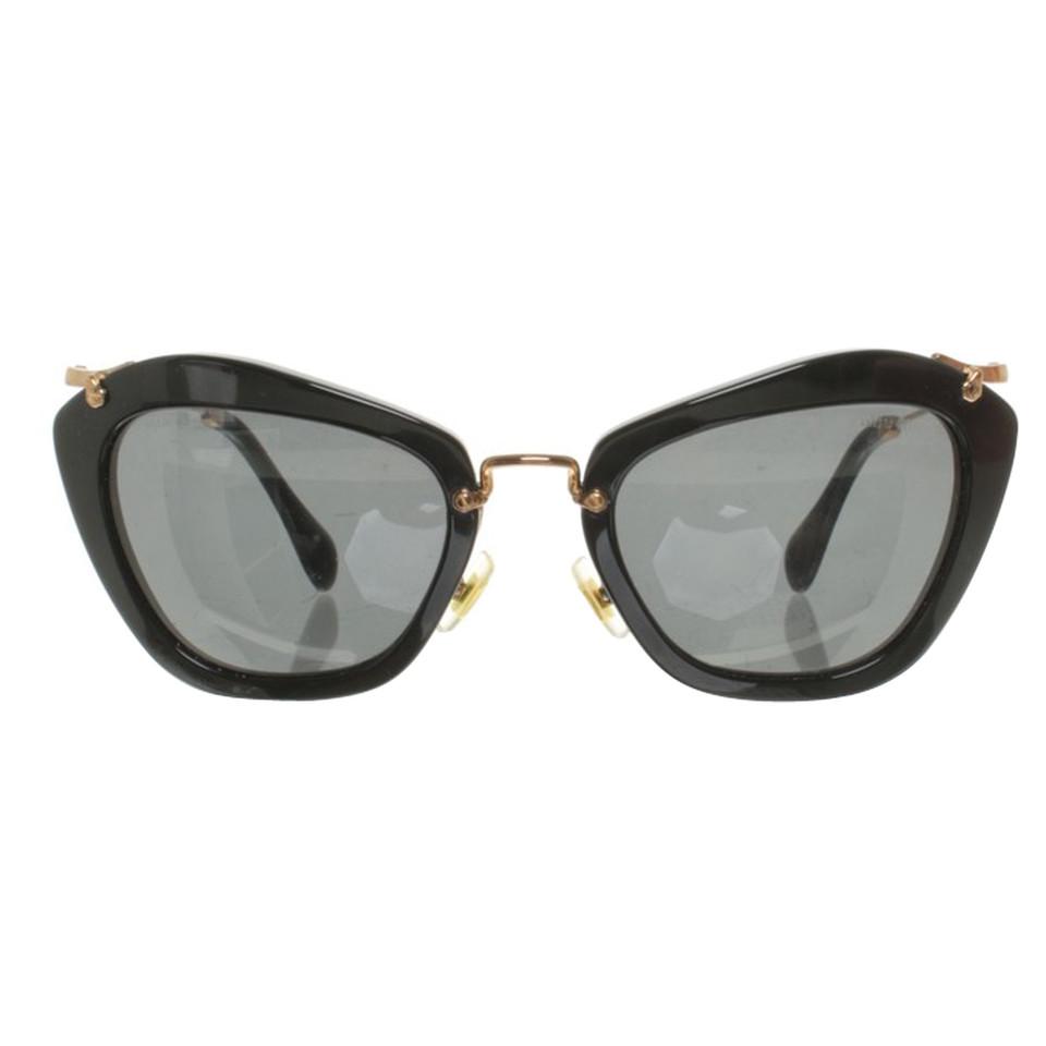 Miu Miu Sonnenbrille in Schwarz