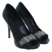 Louis Vuitton  Peep-toes in patent leather
